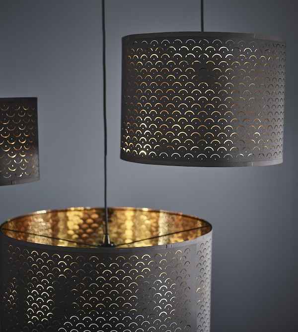 Brass furniture can help a darker room feel light. IKEA has a variety like cylindrical NYMÖ lamp shades with dark blue on the outside and a brass colour on the inside that shines thorugh a decorative, perforated pattern.