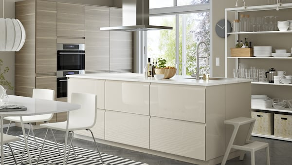 Bright VOXTORP IKEA kitchen with highgloss beige cabinets, stainless steel appliances and walnut effect