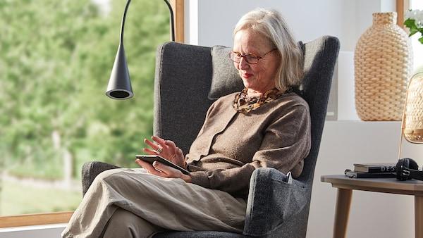 Britt Monti, Creative Leader at IKEA of Sweden, sits in an OMTÄNKSAM armchair.