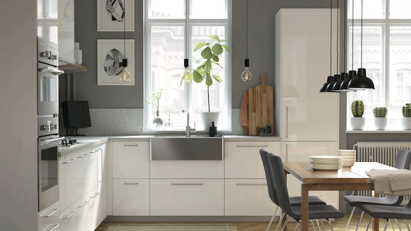 A modern, bright, and airy kitchen with wooden details
