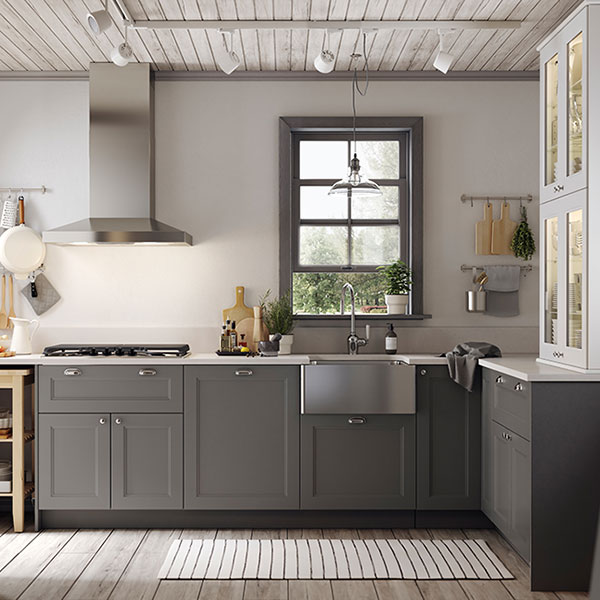 A large kitchen with grey cabinets
