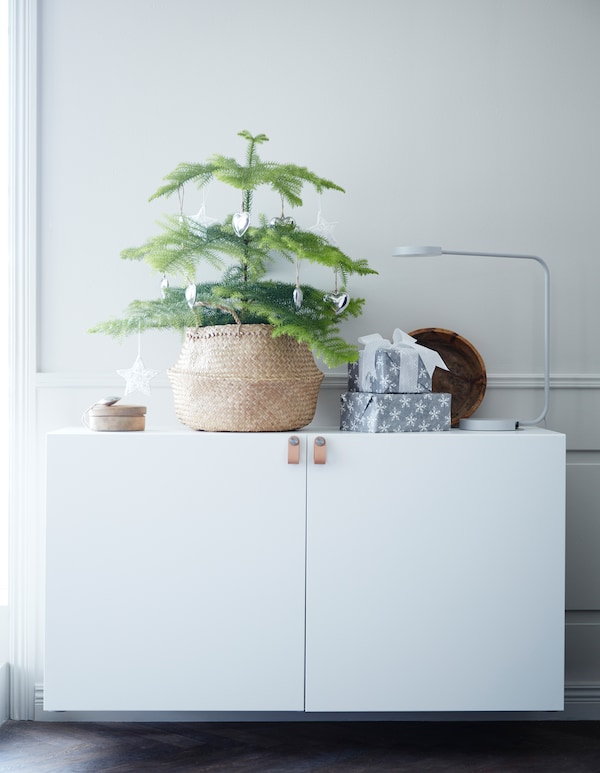 Are you looking for the ultimate Christmas tree this holiday? Try an alternative one! Put a mini tree in a basket on top of a cabinet. IKEA has a broad range of pots and baskets you can use, such as FLÅDIS seagrass basket.