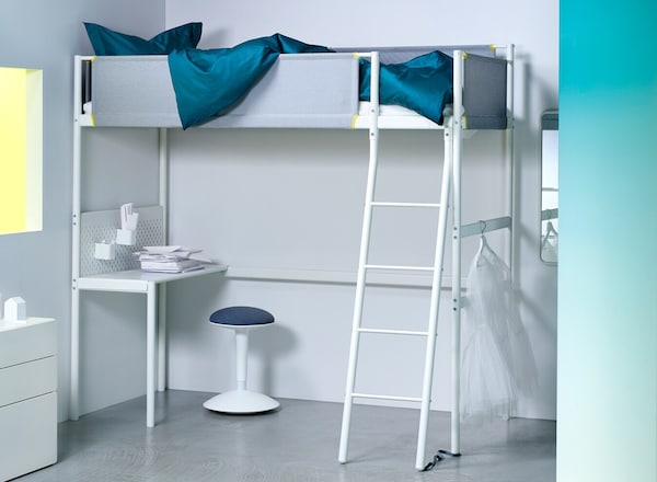 The white VITVAL loft bed with fabric guard rails, a ladder, and an optional desk underneath.