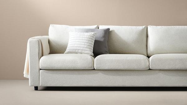 canapé-beige-plaid-coussins