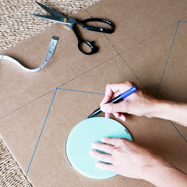 Cardboard box with drawn shapes