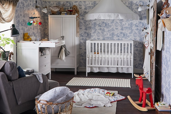 Baby's nursery with white furniture.