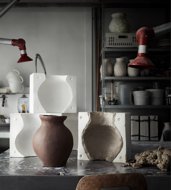 Ceramic vases and molds in a workshop.