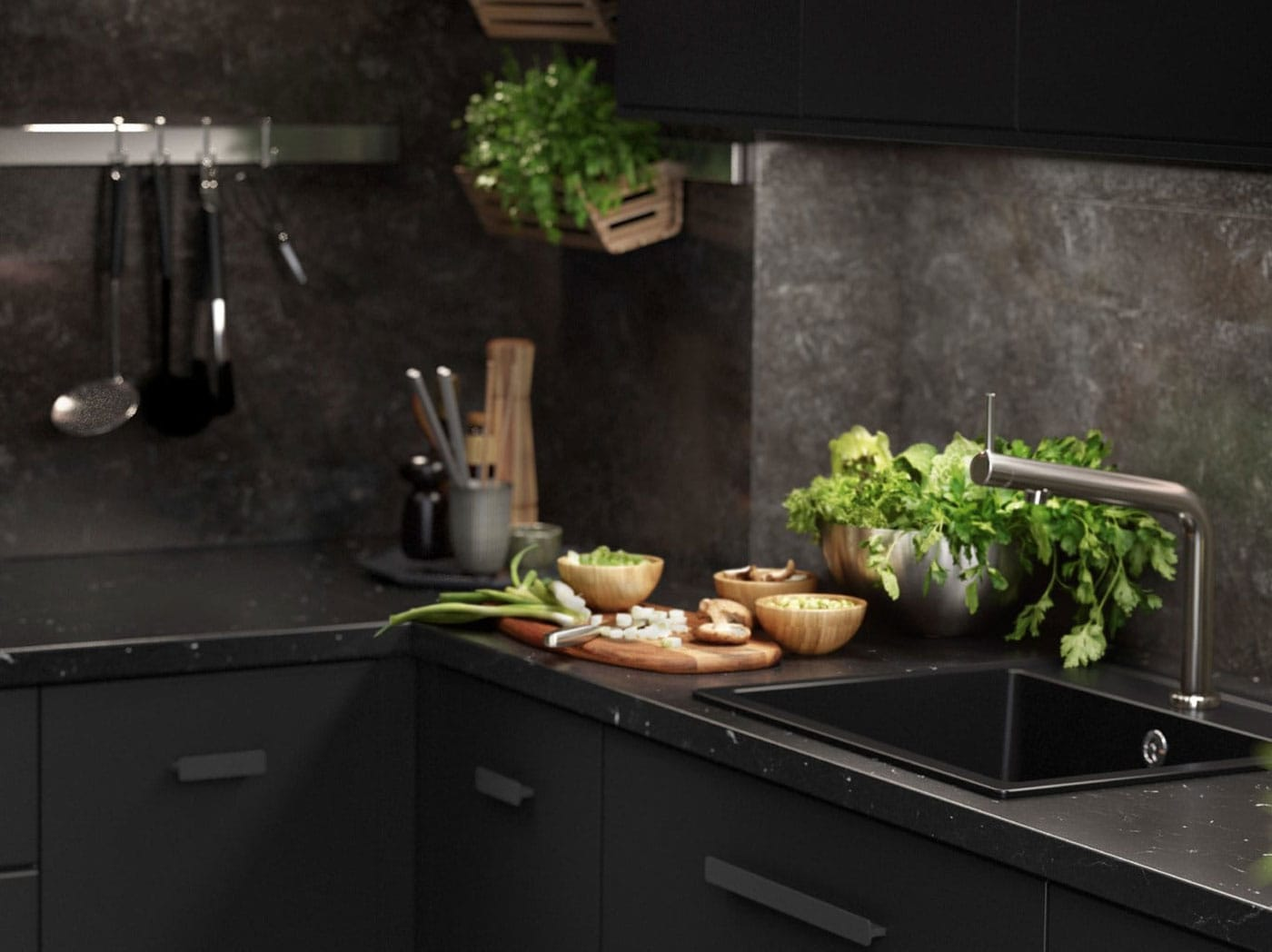 Černá kuchyňská linka Kungsbacka se zeleninou a bylinkami.