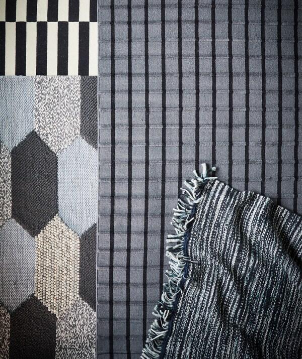 Četiri različita tepiha s monokromatskim prugama i uzorcima.