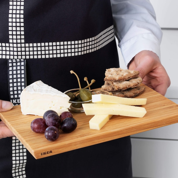 Charcuterie board with snacks, cheese and fruit.
