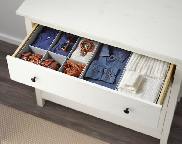 Chest of drawers with neat open drawer