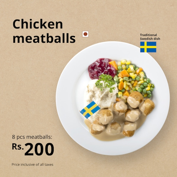 Chicken meatballs plate served with mashed potatoes, vegetables, lingonberry, and cream sauce