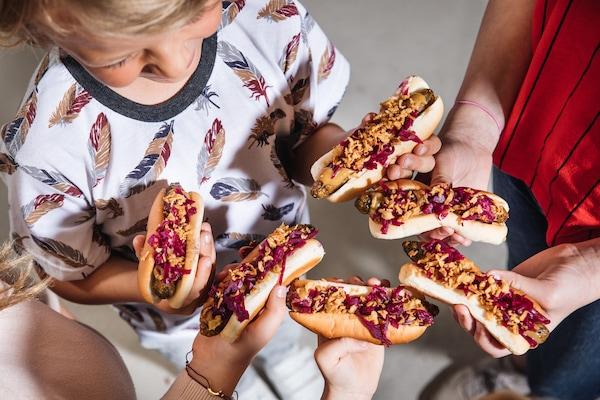 children grab their hotdog which is popular snack at IKEA Bistro