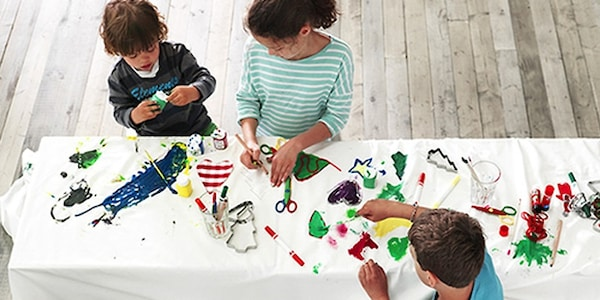 Children painting on a table
