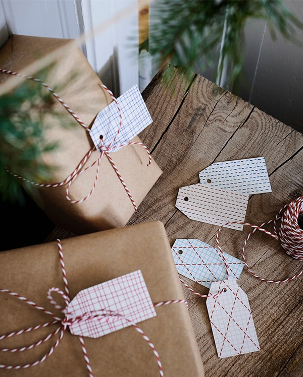 Christmas gifts wrapped in kraft paper with labels