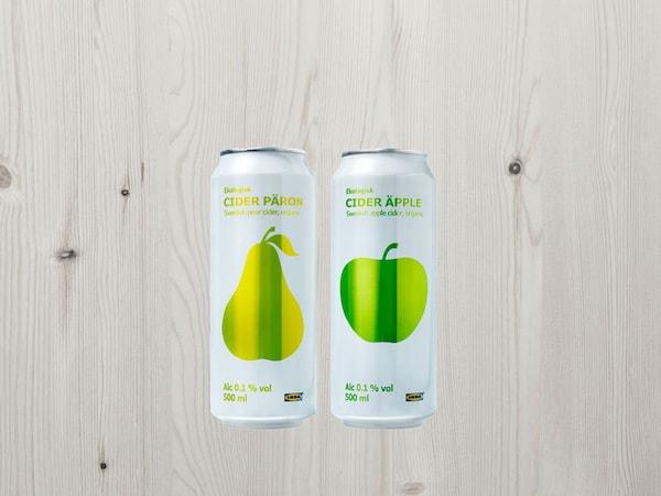 CIDER PÄRON and ÄPPLE sparkling drinks on a wooden background.