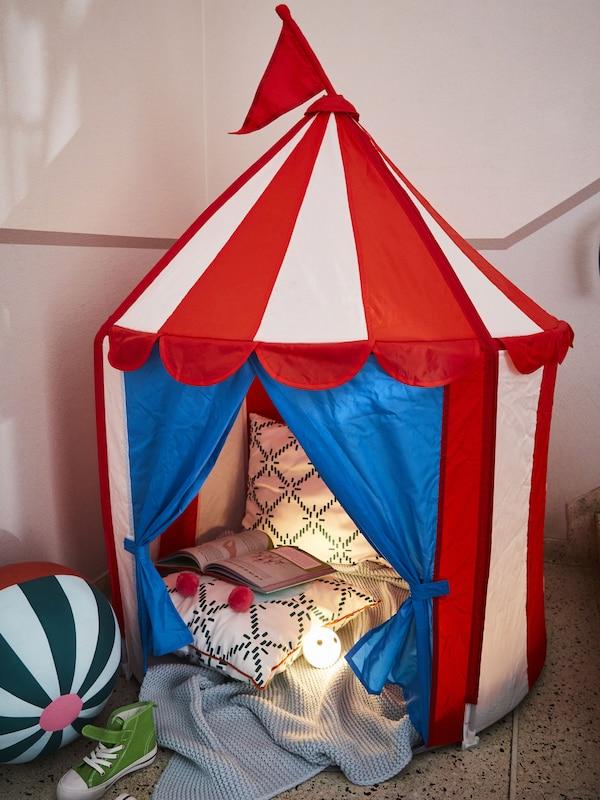 CIRKUSTÄLT children's tent set up as reading nook
