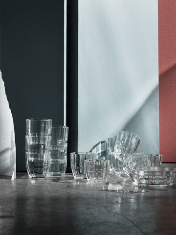 Clear glass bowls and glasses from the LYSKRAFT collection have a wide and low multi-faceted shape.