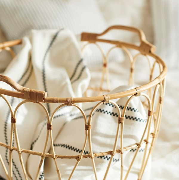 Close up of a rattan basket with pillow cases