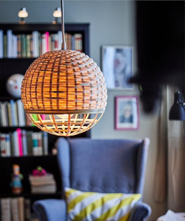 Close-up of an IKEA INDUSTRIELL pendant lamp shaped as a sphere.