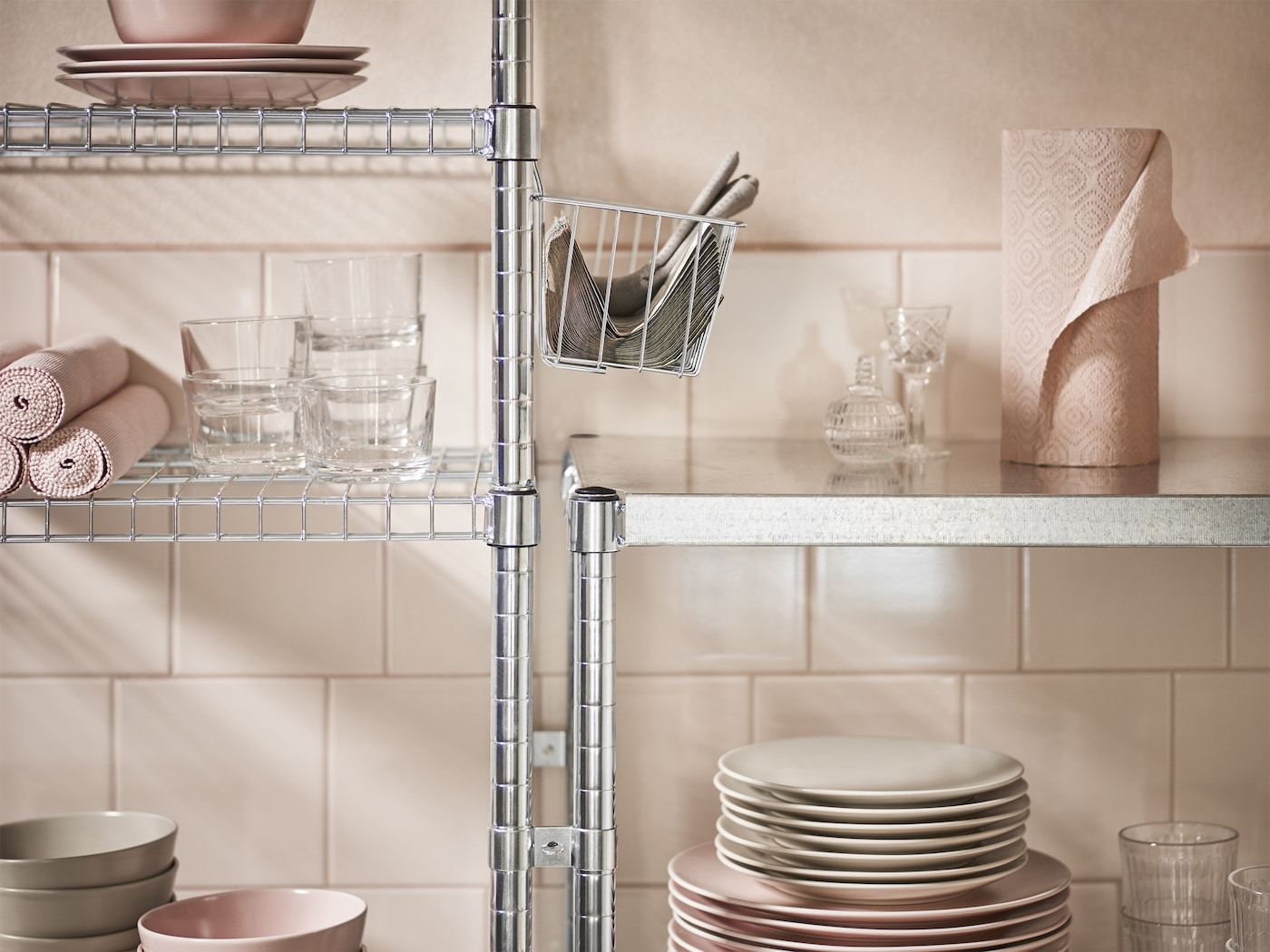 Close-up of shelving units in galvanised steel with a cover for wire shelves to make them more even and stable. Also shown together with a clip-on basket filled with paper napkins.