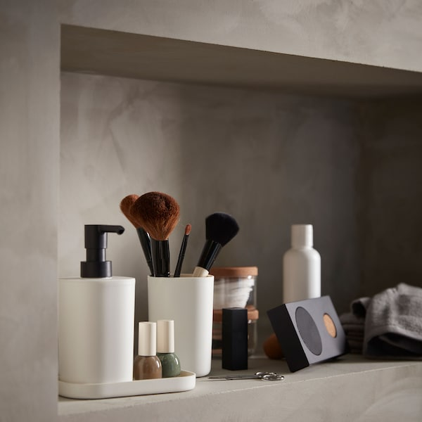 Close up on toiletries and an ENEBY Bluetooth speaker.