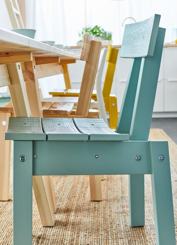Closeup of an IKEA INDUSTRIELL blue chair.