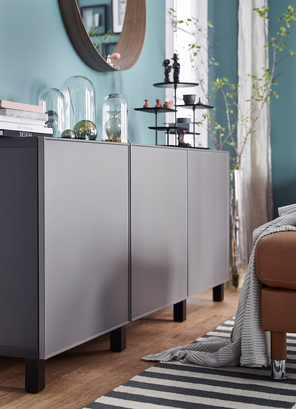 Closeup of IKEA BESTÅ smooth dark grey storage units.