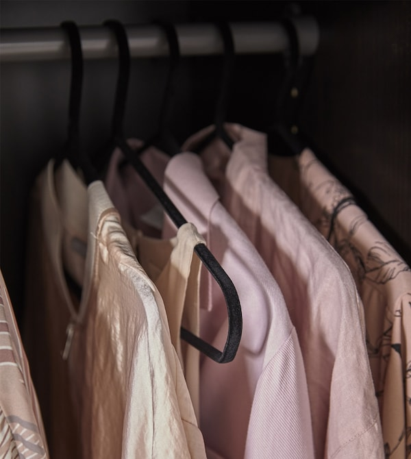 Clothes hangers like STRYKIS from IKEA help keep your clothes in place because they're made of sturdy steel that's covered in velvety, black nylon. Heavier garments can hang, too, and the hangers don't leave marks.