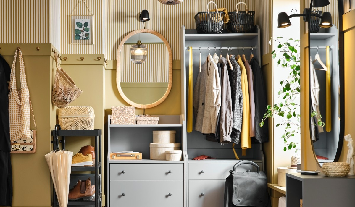 Coats and accessories organised on shelves and in chests of drawers.