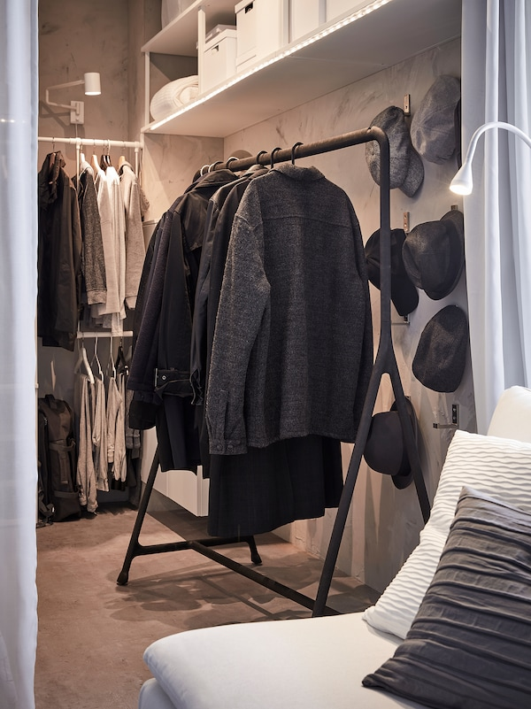 Coats and winter jackets are hanging on a black TURBO clothes rack. It's sturdy so heavier clothes can hang here.