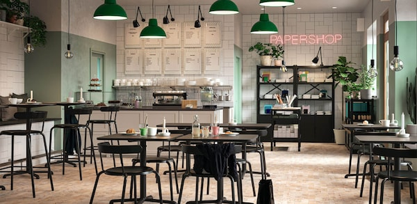 Coffee Shop with Black furniture, green lighting hardware, white cabinets, black bookcases