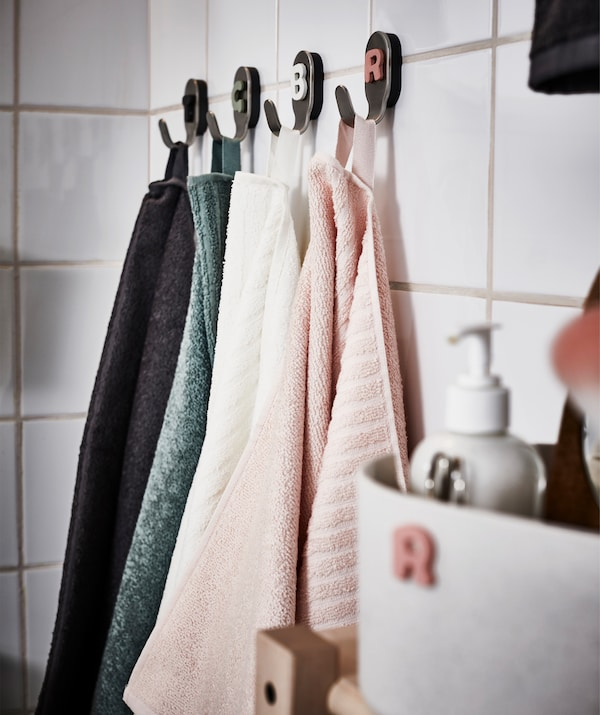 Colour matched bathroom textiles ar both practical and decorative.