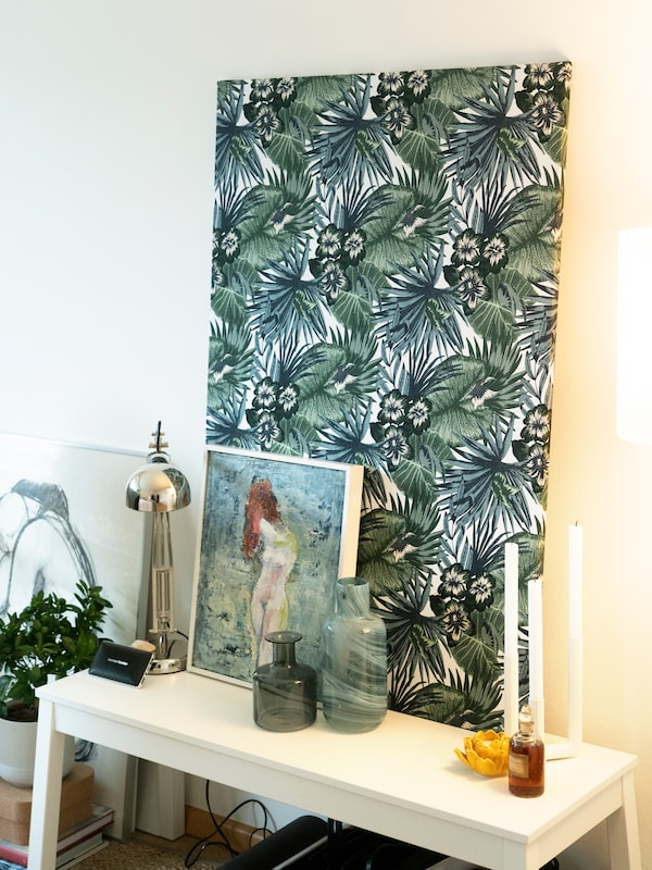Coloured IKEA fabric stretched over picture frames creates a beautiful atmosphere in the bedroom.