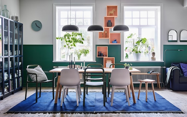 Combine the stackable green YPPERLIG chair with the sofa and ODGER dining chair in white and beige for a relaxed dining room. Green and white walls.