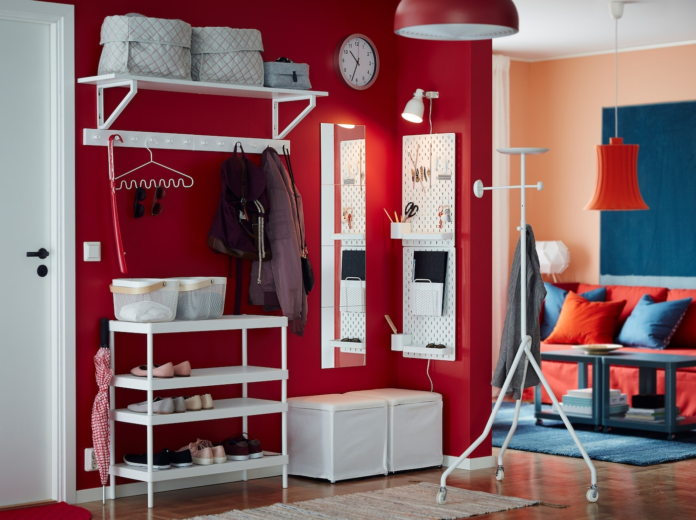 Combine the stackable MACKAPÄR shoe rack with a white wall shelf, footstool and peg board to provide a home for shoes, coats and smaller items in a small, open hallway. A red wall adds an extra warm welcome.