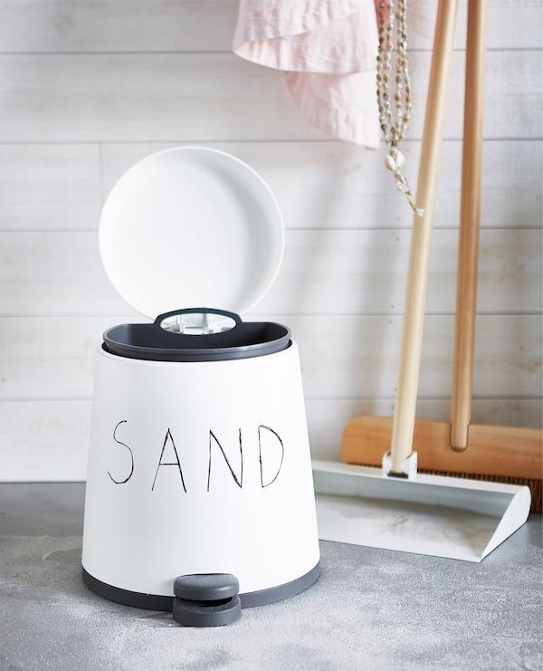 Cómo recoger la arena de la playa en casa.