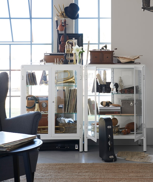 Complement your shelving units with other types of interesting storage, like IKEA KÄMPIG hooks.