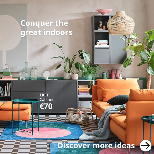 Conquer the great indoors with a bright living room.  With a orange SÖDERHAMN chaise, Grey EKET  open and closed cabinets and wall units.