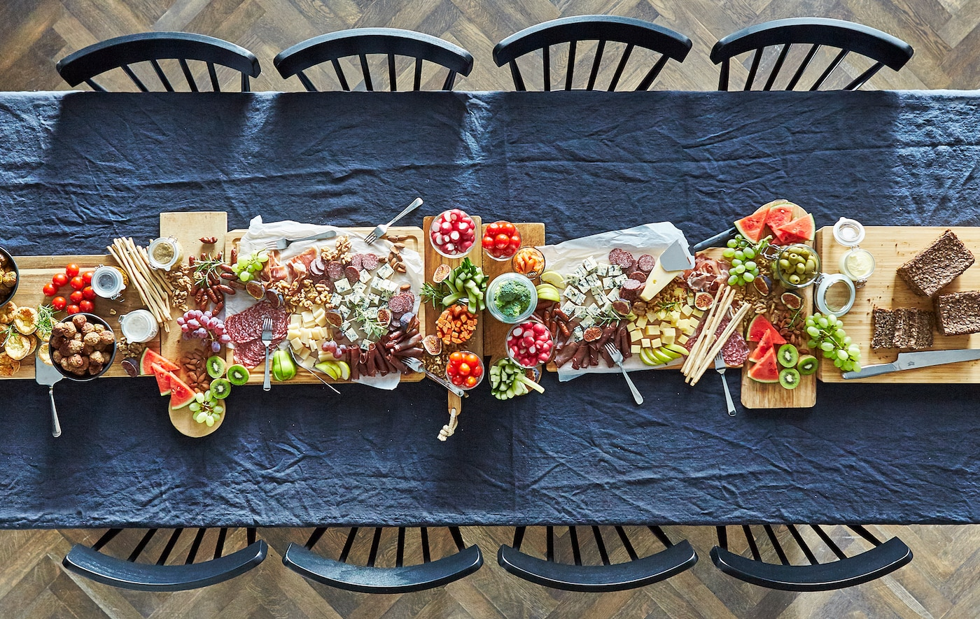 Consider replacing the elaborate, exhausting dinner party with a spread of already-prepared foods. It's visually beautiful and relieves a ton of pressure.