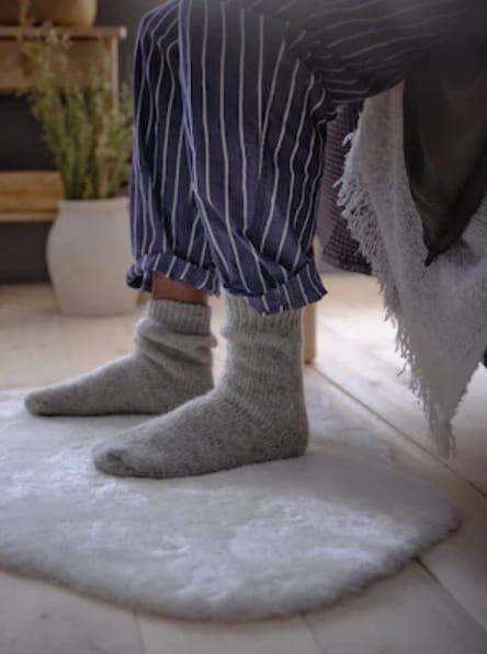 Cosy rug under lady's feet