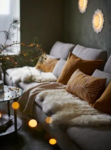 Cosy sofa with cushions and throws