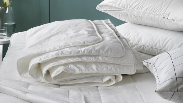 couette blanche avec oreiller ergonomique pour toutes les positions de sommeil