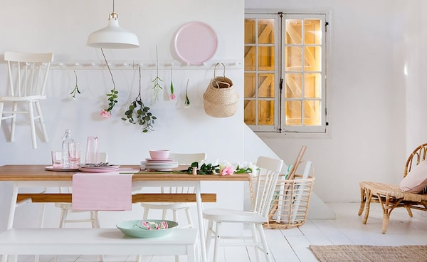Country-style dining room with furniture and accessories in white, wood and light pink