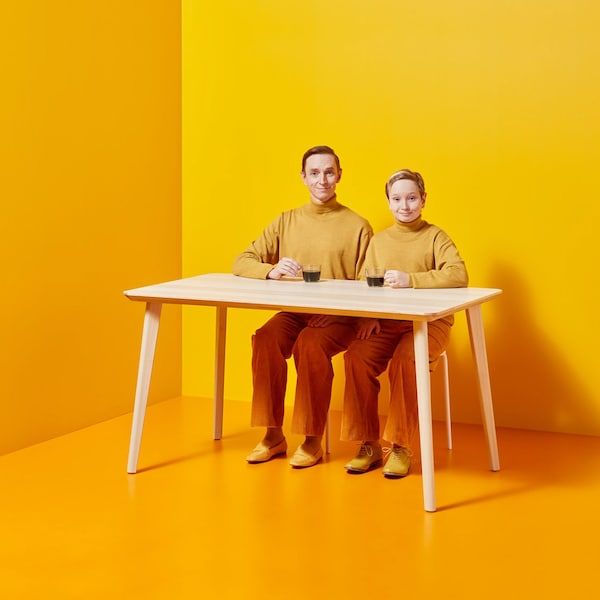 Couple sitting at LISABO dining table