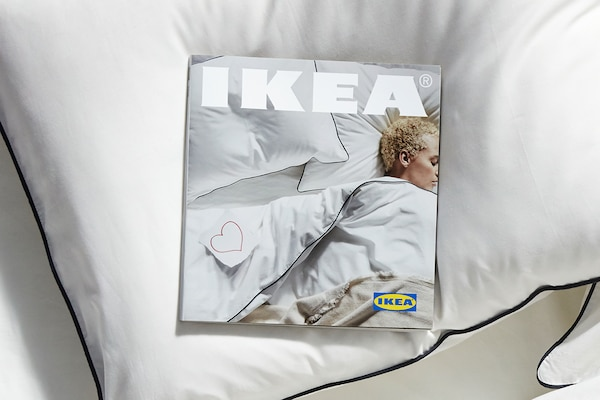 Cover of new IKEA Catalog featuring woman sleeping in bed