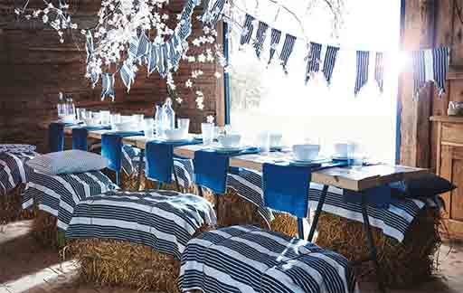 create-a-blue-table-setting-for-a-party-with-nautical-stripes-and-bunting