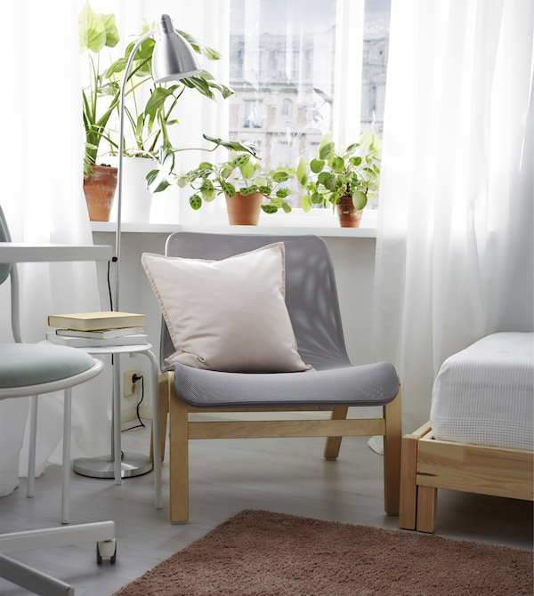 Create a comfortable area to relax with an easy chair, a reading lamp, and some plants.