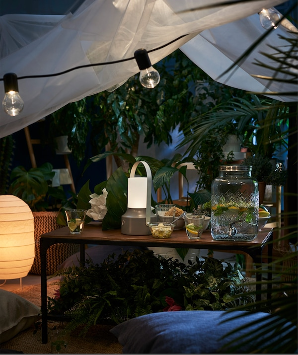 Create a cosy atmosphere with a lighting chain, such as IKEA SVARTRÅ LED black lighting chain with 12 lights.