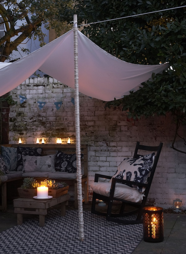 Create a cosy corner with a canopy and lanterns